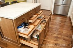 This Island storage is fantastic - custom cabinetry, carrara top