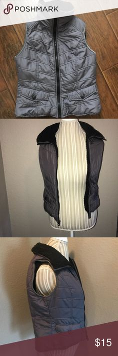 Kennth Cole reaction women's Grey zip up vest Really cozy vest perfect for winter activities . Grey with black Sherpa-esque lining.  Bust:33 Length: 23 Bottom hem: 18 Kenneth Cole Reaction Jackets & Coats Vests