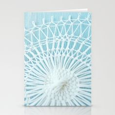 String Art 812 on Shed Stationery Cards x3 by Cally Creates   Society6. One of my hand knotted white string pieces hanging against the painted blue wall of a shed in my garden. Set of 3 cards . Blank inside, includes envelope. (blue - turquoise - wood - rustic - shabby chic - decorative - patterned - weave - mesh)  www.callycreates.blogspot.co.uk www.facebook.com/cally.creates/