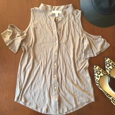 Taupe button down top with cut out shoulders Taupe button down with a slight v neck and cut out shoulders and short sleeves. By staring at stars from Urban Outfitters. 50% Pima cotton, 50% modal. Worn once and in great condition. Urban Outfitters Tops