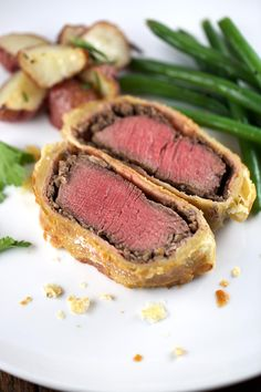 Individual Beef Wellington with Mushroom Sauce - Consider making this recipe for tender filet mignon wrapped in golden puff pastry for your next special occasion! | jessicagavin.com