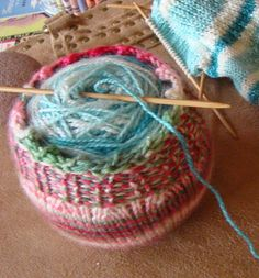 Free Knitting Pattern for Yarn Cozy - This easy cozy is a great way to corral your yarn ball or cake to keep it neat or to protect your apple or pear from bruising in a lunch bag. Great stash buster, stocking stuffer, or gift for knitter. Designed by Susan B. Anderson.