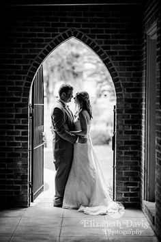 Brian & Mary's wedding @ St. John's Episcopal Church in Tallahassee, Florida | Elizabeth Davis Photography Weddings | bride and groom stand silhouetted in an archway. Click here to see the rest of the wedding: http://elizabethdavisphotoblog.com/brian-marys-wedding-photography-april-27/
