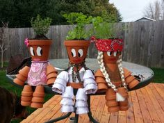 Pot people herb garden we made for my Mom's birthday...Patsy Thyme, Elvis Parsley, and Dilly Nelson!