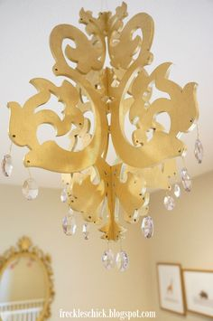 Love!  Buy these laser cute wood chandeliers off Etsy & spray paint and embelish your self.
