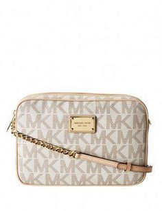 19f983c2450b Michael Kors lets you show your modern style with this must have crossbody.  This bag