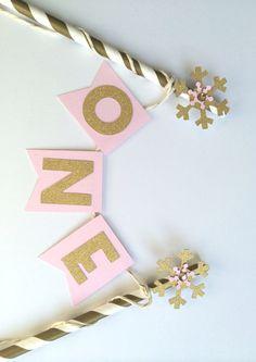 PINK & GOLD Snowflake Birthday Smash Cake Topper - 1st Birthday, Cake Bunting, Snow Cake Topper, Winter ONEderland by PaperTrailbyLauraB on Etsy https://www.etsy.com/listing/215828186/pink-gold-snowflake-birthday-smash-cake