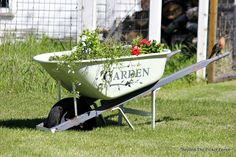 Garden Wheelbarrow planter filled with summer flowers, painted with Tones for Tots Little Speckled Frog - Fusion Mineral Paint using Funky Junk's Old Sign Stencils | http://bec4-beyondthepicketfence.blogspot.com/2016/05/welcome-to-my-gardenstencil-paint.html