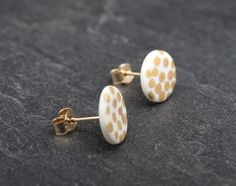 A personal favourite from my Etsy shop https://www.etsy.com/uk/listing/249069738/porcelain-9ct-gold-post-earrings-spotty