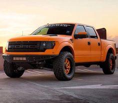 Orange colored Raptor SVT Truck