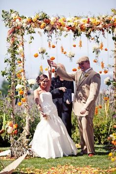 white yellow and orange flowers wedding arch for rustic fall weddings