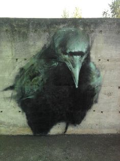 Mesa street art of a crow