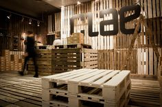Now this is how to make your pop-up shop interior affordable...use pallets, long screws, some paint, cardboard boxes, lighting and signage. Ha. Good job nonetheless by the design firm and CLAE. Pop-Up Store by mode:lina