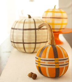 Not up for the mess that comes with carving? Give your Halloween centerpiece a preppy (and longer-lasting) look.