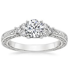 THIS IS THE RING I WANT NO DOUBT ABOUT IT. Future husband needs to get a pinterest so they can see this!  18K White Gold Adorned Trio Diamond Ring from Brilliant Earth