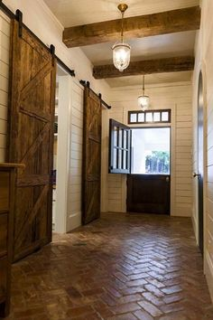 Country Entryway with Barn door, Antique copper finish waved glass lantern chandelier, Pendant light, Exposed beam