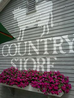 JUST PLAIN COUNTRY CHARM <3 A pretty flower box at the old Country Store.