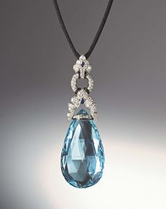 Art Deco aquamarine briolette pendant set with diamonds, two fancy-cut sapphires as well as bands of black enamel set in platinum by Marzo, Paris, circa 1925.