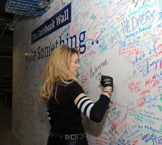 """Madonna signed """"the Wall"""" at Facebook's New York office. She was there to do a live chat with JImmy Fallon. Click through to read our WSJ story about Madonna's embrace of social media. (Photo: Dimitrios Kambouris for Getty Images, provided by Facebook.)"""