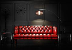Amazing contrast between the chesterfield and the black wall! Love the lamp :)