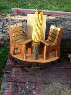 New squirrel feeder with pine slab and chairs.