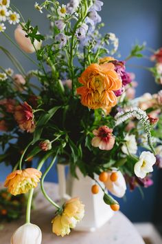 a colorful spring floral arrangement inspired by dutch paintings | floral tutorial on coco kelley