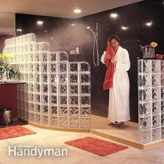 A glass block wall installation can turn an ordinary bathroom into a dramatic showpiece. Step-by-step photos and clear instructions show how to do it. Glass Blocks Wall, Block Wall, Glass Brick, Brick And Stone, Diy Fire Pit, Fire Pit Backyard, Building A Shower Pan, Glass Block Shower, Brick Pathway