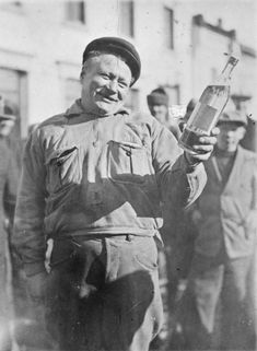 Blacksmith Pirttimäki, the first customer of a post-prohibition liquor store, receives a free bottle after queuing overnight. Iisalmi, Finland, 1932 [[MORE]] Source Frank Horvat, The One, The Past, End Of Prohibition, Liquor Store, Blacksmithing, Apocalypse, Old Photos, Finland