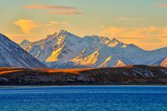 Snow capped mountain across Lake Tekapo #NZ #Tekapo #lake #snow #mountain #sunset
