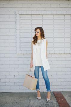 sleeveless white blazer, blue skinny jeans, statement necklace
