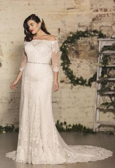 badbdecaed N Y C - Bianca - True Curves by True Bride. A classic off-the-shoulder  neckline and sweeping train pair beautifully with a sleek, modern  silhouette.