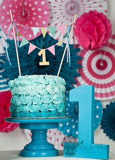 Turquoise Ombre Cake- totally doing this with different flavored cakes set around the wedding cake!!