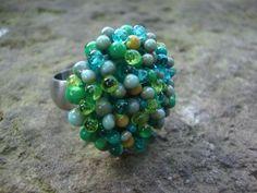 7 tinten groene dots ringtop, verwisselbaar aan rvs ring. Met bijpassende hanger(s)