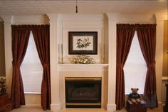 Fireplace surround featuring fluted columns, and recessed panels over boxed mantel. Includes hidden access to flat screen TV