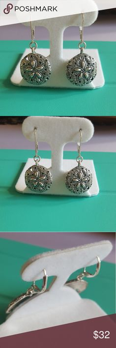 Silver sand dollar dangle earrings Silver sand dollar dangle earrings . With a secure locking back for a secure hold. Great for amytime of year, but perfect with summer time quickly approaching Jewelry Earrings