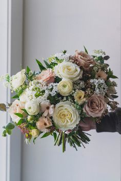 Our bride held this bridal bouquet on the first day of spring and has many of our favorite spring blooms including viburnum tinus, #butterflyranunclus , ranunculus, garden roses and allium neapolitanum. 📷 @castanofilms #springbridalbouquet #ranunculusbouquet #alabasterrose #quicksandroses #calgary #banffwedding #calgaryflorist #springwedding #flowersbyjanie Ranunculus Bouquet, Flower Girl Bouquet, Bridesmaid Bouquet, Bridal Bouquets, Floral Wedding, Wedding Flowers, Bouquet Toss, Most Beautiful Flowers, Spring Blooms