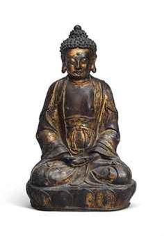 一個鍍金漆的青銅坐像釋尊