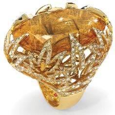 Roberto Coin's Haute Couture cocktail ring is a stunning rutilated quartz surrounded by cognac diamonds set in 18-karat gold.