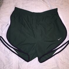 Nike Shorts Another pair of hunter green Nike running shorts! These have been worn once while painting, so there are a few paint splatters as shown in the picture, can probably be washed off. Nike Shorts