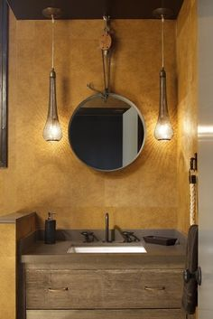 bathroom designed by artistic designs for living | arteriors lights + rustic wood vanity