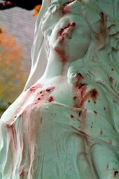 Grave of opera singer Jane Margyl, Batignolles Cemetery, Paris. The appearance of blood stains is caused by fallen flower petals.