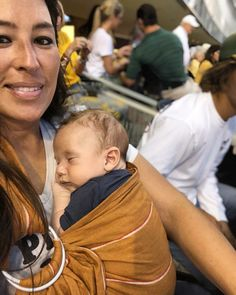 Joanna Gaines brought two-month-old Crew to his first college football game on Saturday. The television personality carried the adorable infant in a sling as the two watched the Baylor Bears