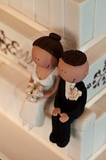 "I like this idea for the bride and groom instead of the traditional ""on top"" versions. I never HAVE liked those. I used to cringe when I'd do a wedding cake for a couple and they'd have these atrocious ""things"" to put on top. Three days of work to be ""uglied up"" by some plastic yuk."