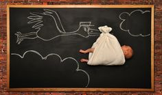 mother creates cute blackboard adventures for her sleeping baby!