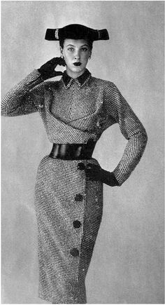 1951 Model in black and white tweed dress, buttoned on the side, high velvet collar, worn with wide black leather belt, by Jacques Griffe
