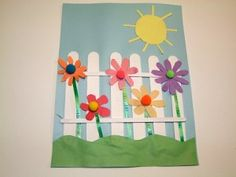 Picket fence in the spring... popsicle sticks,paper coffee straws  pompons, paper flowers and grass/sun