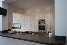 Gloss Ivory Fusion Kitchen with Granite worktop by Saffron Interiors  #granite #cream #ivory #gloss #kitchen #saffron