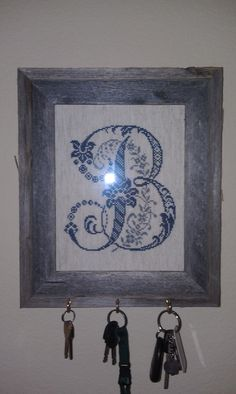 "I harnessed all of my inner creativity for this one! I found a super cute cross stitch pattern for my monogram & stitched it on a #14 Ada in Oatmeal. I chose a distressed wood frame, added a frame hanger to the backside, and added three 1"" cup hooks to the bottom for keys :) Voila!"