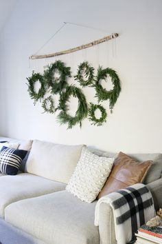 Homemade wreaths in the family room Homemade Wall Decorations, Homemade Wreaths, Xmas Decorations, Natural Christmas, Christmas Diy, Christmas Wreaths, Decorating Your Home, Diy Home Decor, Jones Design Company