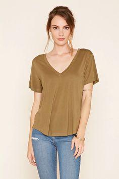 A slub knit tee featuring a deep V-neckline, short sleeves and a slightly curved hem. #f21contemporary